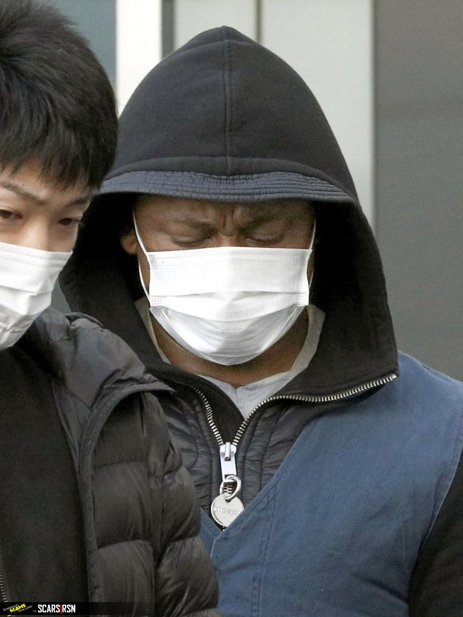 A suspect arrested in a case involving an online romance scam is taken to Fukuoka Prefecture on Tuesday